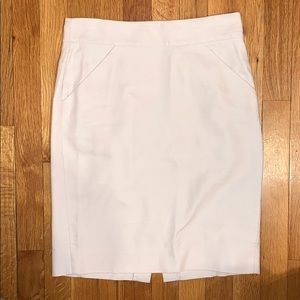 Women's ivory pencil skirt with pockets and slit